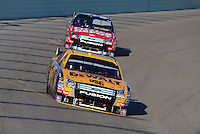 Nov. 16, 2008; Homestead, FL, USA; NASCAR Sprint Cup Series driver Matt Kenseth leads teammate Carl Edwards during the Ford 400 at Homestead Miami Speedway. Mandatory Credit: Mark J. Rebilas-