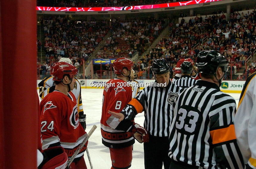 Officials try break up a fight during an NHL hockey game between the Carolina Hurricanes and the Boston Bruins Saturday, Dec. 2, 2006 in Raleigh, N.C. Carolina won 5-2.<br />