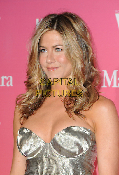 JENNIFER ANISTON .at The Women in Film 2009 Crystal .and Lucy Awards held at The Hyatt Regency Century Plaza in Century City, California, USA, June 12th 2009                                                                     .portrait headshot gold silver metallic shiny bustier cleavage strapless hair down wavy .CAP/DVS.©DVS/RockinExposures/Capital Pictures