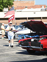NWA Democrat-Gazette/FLIP PUTTHOFF <br /> PATRIOTIC RIDE<br /> Mike Maule of Rogers looks over vintage automobiles on Saturday July 7 2018 at the monthly Coffee and Cars event in downtown Springdale. Coffee and Cars takes place the first Saturday of the month April through October along Emma Avenue south of Shiloah Square. Saturday's show had a patriotic theme to honor Independence Day. There's no charge for vehicle owners to enter the car show, and people can vote for their favorite cars and trucks. Winners get plaques, said Jennifor Joyner with Downtown Springdale Alliance.
