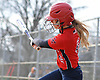 Ashley Budrewicz #4 of MacArthur plates the game-tying run on a fielder's choice in the top of the seventh inning of a Nassau County varsity softball game against host Oceanside High School on Thursday, Mar. 31, 2016. MacArthur scored three more times in the frame to win by a score of 5-2.