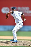 Asheville Tourists pitcher Julian Fernandez (22) delivers a pitch during a game against the Greensboro Grasshoppers at McCormick Field on April 30, 2017 in Asheville, North Carolina. The Grasshoppers defeated the Tourists 7-0. (Tony Farlow/Four Seam Images)