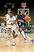 January 14, 2010:     Lipscomb guard Johnny Lee (3) tries to dribble past Jacksonville guard Russell Powell (2) during Atlantic Sun conference game action between the Jacksonville Dolphins and the Lipscomb Bisons at Veterans Memorial Arena in Jacksonville, Florida.  Jacksonville defeated Lipscomb 79-73.
