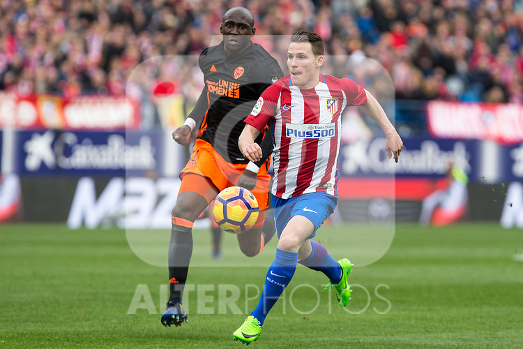 Kevin Gameiro of Atletico de Madrid  competes for the ball with Eliaquim Mangala of Valencia CF during the match of Spanish La Liga between Atletico de Madrid and Valencia CF at  Vicente Calderon Stadium in Madrid, Spain. March 05, 2017. (ALTERPHOTOS / Rodrigo Jimenez)