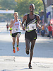 Ahmed Osman of Flagstaff, AZ (Bib No. 4) legs out the final stretch of Northport's annual Cow Harbor 10-kilometer run on Saturday, September 19, 2015. He finished in fourth place with a time of 30:38.60.<br /> <br /> James Escher