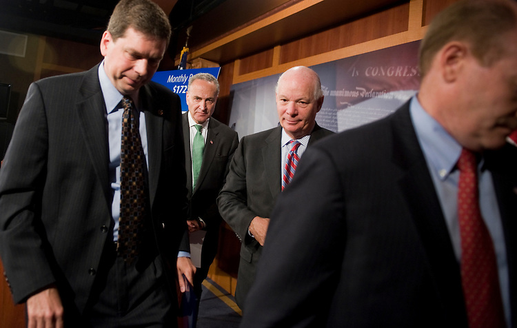 UNITED STATES - JULY 14:  From left, Sens. Mark Begich, D-Alaska, Charles Schumer, D-N.Y., Ben Cardin, D-Md., and Chris Coons, D-Del., wrap up a news conference in the Capitol on the impasse in debt ceiling talks.  (Photo By Tom Williams/Roll Call)
