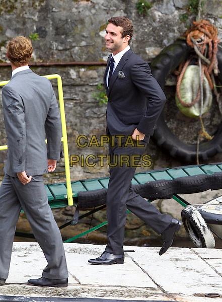 Pierre Casiraghi, Stavros Niarchos (son of the Greek shipowner Stavros Spyros Niarchos), wedding of Prince Antonius of Fürstenberg and Countess Matilde Borromeo, Isola Bella, Lago Maggiore, Italy, 11 June 2011.full length black grey gray suit jacket side profile .CAP/PPG/WS.©Willi Schneider/People Picture/Capital Pictures