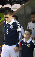 Paul Hanlon leads the team out with the mascot in the Scotland v Luxembourg UEFA Under 21 international qualifying match at St Mirren Park, Paisley on 6.9.12.