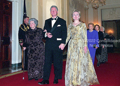United States President Bill Clinton, center, escorts former first lady Lady Bird Johnson, left, and current first lady Hillary Rodham Clinton, right, to the 200th Anniversary of the White House Dinner in Washington, D.C. on November 9, 2000. Also visible at right are former first lady Betty Ford, former first lady Rosalynn Carter, and former first lady Barbara Bush.<br /> Credit: Ron Sachs / CNP