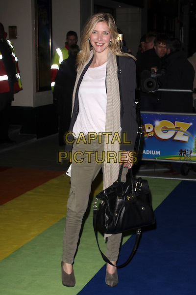 "LISA FAULKNER.The Press Night for the new musical stage production of the ""Wizard of Oz"", London Palladium, London,.England, UK..March 1st, 2011.full length scarf black jacket bag khaki jeans trousers grey gray shooboots shoes striped .CAP/AH.©Adam Houghton/Capital Pictures."