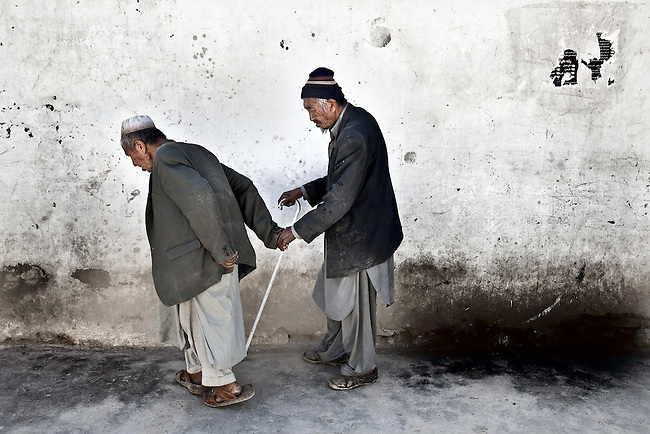Two elderly Afghan men  hold hands after  casting their ballot's in today's historic Afghan Presidential elections. Kabul was in a virtual security lockdown after Taliban threats to disrupt the elections with violence left officials concerned about voter turnout.