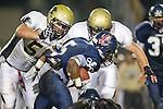 Lawndale, CA 10/21/11 - Devin Christy (Leuzinger #5), Joey Augello (Peninsula #58) and Will Cummins (Peninsula #83) in action during the Peninsula - Leuzinger varsity football game.
