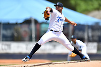 Asheville Tourists starting pitcher Alfredo Garcia (26) delivers a pitch during a game against the Delmarva Shorebirds at McCormick Field on May 5, 2019 in Asheville, North Carolina. The Shorebirds defeated the Tourists 10-9. (Tony Farlow/Four Seam Images)
