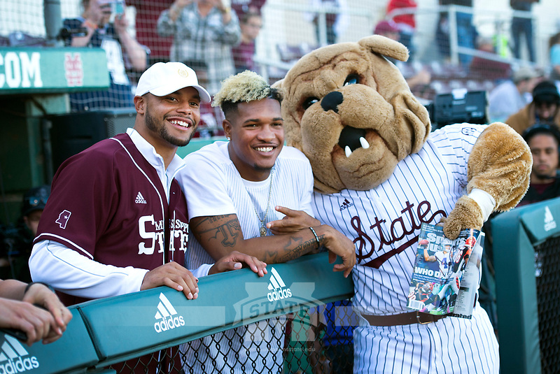 Former Mississippi State University quarterback Dak Prescott, receiving some counsel from former wide receiver Fred Ross and Bully, prepares to throw out the first pitch Friday night before the Bulldogs took on the University of Kentucky in a three-game series for Super Bulldog Weekend. <br /> (photo by Russ Houston / &copy; Mississippi State University)