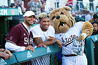 Former Mississippi State University quarterback Dak Prescott, receiving some counsel from former wide receiver Fred Ross and Bully, prepares to throw out the first pitch Friday night before the Bulldogs took on the University of Kentucky in a three-game series for Super Bulldog Weekend. <br />