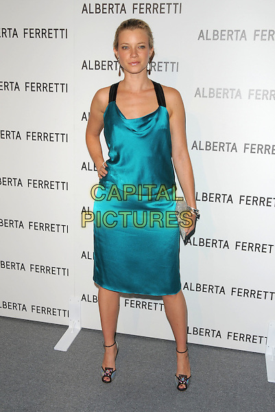 AMY SMART.The Opening of Alberta Ferretti Flagship on Melrose hosted by Alberta Ferretti, Marisa Tomei, Lucy Lui & Vogue in Los Angeles, California, USA..November 12th, 2008.full length dress turquoise silk satin clutch bag silver green hand on hip .CAP/DVS.©Debbie VanStory/Capital Pictures.