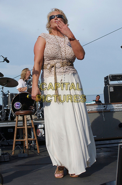 TANYA TUCKER.2005 CMA Music Festival held at the Greased Lightning Daytime Stage, Nashville, Tennessee, USA,.09 June 2005..full length live concert gig sunglasses blowing kiss gesture.Ref: ADM.www.capitalpictures.com.sales@capitalpictures.com.©George Shepherd/AdMedia/Capital Pictures.