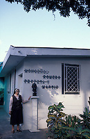 Nun standing next to the former house of liberation theologist Archbishop Oscar Romero on the grounds of the Divina Providencia Hospital in San Salvador, El Salvador