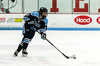 BOSTON, MA - JANUARY 04: Taylor Leech #2 of University of Maine brings the puck forward during a game between University of Maine and Boston University at Walter Brown Arena on January 04, 2020 in Boston, Massachusetts.