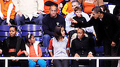 United States President Barack Obama waves as his wife First Lady Michelle Obama and daughters Malia and Sasha look on during a college basketball game at Howard University, Saturday, November 27, 2010 in Washington, DC. President Barack Obama attended the game between Howard University and Oregon State, which is coached by his brother in law Craig Robinson..Credit: Olivier Douliery / Pool via CNP