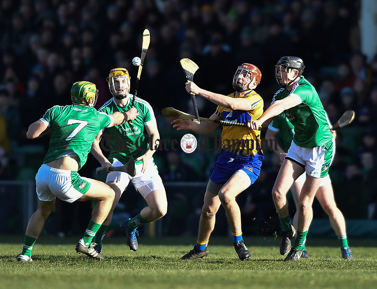 Peter Duggan of  Clare  in action against Dan Morrissey and Diarmuid Byrnes of  Limerick during their NHL quarter final at the Gaelic Grounds. Photograph by John Kelly.
