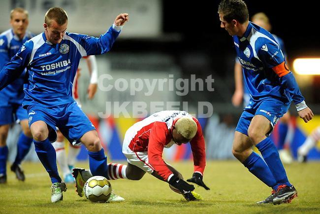 EMMEN - Voetbal, FC Emmen - FC  Den Bosch, Jupiler League, Unive stadion, seizoen 2011-2012, 20-02-2012 Emmen speler Matthieu gaat onderuit tussen twee speler van den Bosch met rechts Paco van Moorsel.