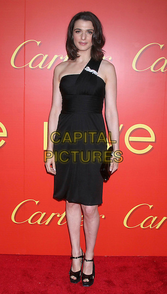 RACHEL WEISZ.At the Cartier's Celebration of the Cartier Charity Love Bracelet at the The Cartier Mansion, New York, NY, USA..June 7th, 2007 .full length black one shoulder dress brooch  clutch purse platform shoes mary janes .CAP/IW.©Ian Wilson/Capital Pictures