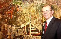 """Jan 29, 2002, Montreal, Quebec, Canada; <br /> <br /> CIBC Chairman & CEO John Hunkin, photographed at the Montreal Museum of Fine Art, January 29, 2002 with the painting  """"Hommage ŕ Grey Owl"""" by Jean-Paul Riopelle that the CIBC donated to the Montreal Museum of Fine Arts. The painting has hung on the wall of the top floor of CIBC's head office in Toronto for the last 25 years.<br /> <br /> Stockbrokers from the CIBC and from 3 other financial institution are currently (Jan 30, 2002) under investigation by 3 Canadian Stock Exchange Commissions and also by the London (UK) Stock Exchange, for insider trading during the buy of  Canadian Hunter Exploration and other deals.<br /> <br /> (Mandatory Credit: Photo by Sevy - Images Distribution (©) Copyright 2002 by Sevy<br /> <br /> NOTE :  D-1 H original JPEG, saved as Adobe 1998 RGB"""