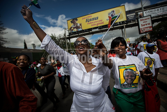 On its arrival in Mthatha, near Qunu, mourners line the streets to sing and dance as the convoy makes its way towards the Mandela's ancestral home. The funeral will take place on Sunday