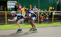 11 AUG 2013 - BIRMINGHAM, GBR - Jon Morrison  (left) of London Skaters Speed Team is propelled forward at the changeover by team mate Gibran Ghazali (right) during the Junior and Senior Men's 3000m Relay at the Federation of Inline Speed Skating 2013 British Outdoor Championships at Birmingham Wheels Park in Birmingham, West Midlands, Great Britain (PHOTO COPYRIGHT © 2013 NIGEL FARROW, ALL RIGHTS RESERVED)