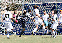 Andy Riemer #20 of Georgetown University watches his shot beat Avery Steinlage #0 of Michigan State for a goal during an NCAA match at North Kehoe Field, Georgetown University on September 5 2010 in Washington D.C. Georgetown won 4-0.
