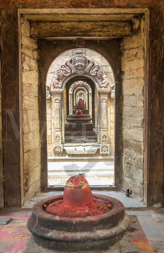 Kathmandu., Nepal A view down the arch-ways at the Shrine of Nobility in Pashupatinath;