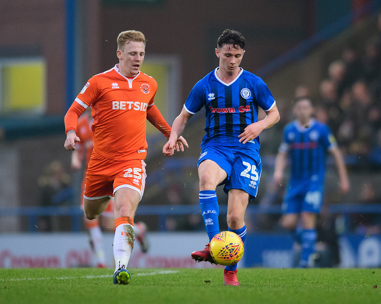 Rochdale's Daniel Adshead under pressure from Blackpool's Callum Guy<br /> <br /> Photographer Chris Vaughan/CameraSport<br /> <br /> The EFL Sky Bet League One - Rochdale v Blackpool - Wednesday 26th December 2018 - Spotland Stadium - Rochdale<br /> <br /> World Copyright © 2018 CameraSport. All rights reserved. 43 Linden Ave. Countesthorpe. Leicester. England. LE8 5PG - Tel: +44 (0) 116 277 4147 - admin@camerasport.com - www.camerasport.com