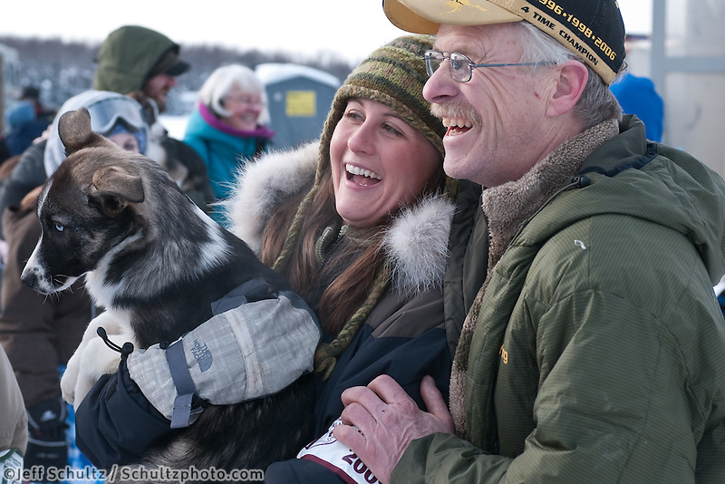 Jeff King poses with a race fan and one of his puppies at the 2009 Iditarod Restart in Willow, AK.