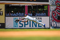 Byron Buxton (7) of the Chattanooga Lookouts fields and attempts to make a diving catch during a game between the Jackson Generals and Chattanooga Lookouts at AT&T Field on May 10, 2015 in Chattanooga, Tennessee. (Brace Hemmelgarn/Four Seam Images)