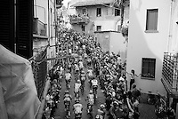 peloton on the 1st ascent of the very steep (20%) cobbled Via Principi d'Acaja<br /> <br /> stage 18: Muggio - Pinerolo (240km)<br /> 99th Giro d'Italia 2016