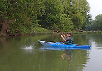 NWA Democrat-Gazette/FLIP PUTTHOFF <br /> A good-sized smallmouth bass comes unhooked Aug. 16 2019 next to Alan Bland's kayak. Bland got a good look at the fish and knows it was big.