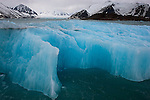 Norway, Svalbard, blue drift ice in fjord, mountains and glacier in background