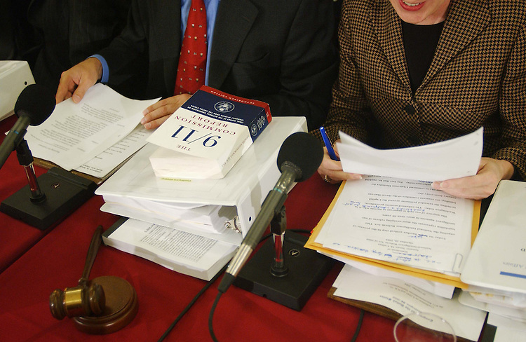 10/20/04.INTELLIGENCE REORGANIZATION--A copy of the Sept. 11 Commission's report sits in front of House Select Intelligence Chairman Peter Hoekstra, R-Mich., and Senate Governmental Affairs Chairman Susan Collins, R-Maine, at the start of the House-Senate conference to consider S2845, the National Intelligence Reform Act of 2004, which would reorganize U.S. intelligence gathering and analysis operations..CONGRESSIONAL QUARTERLY PHOTO BY SCOTT J. FERRELL