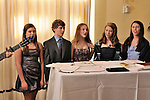 Family prayers and candles are integral to special Hebrew Wizards Bat Mitzvah and Bar Mitzvah servcies.