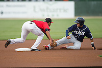 Emmanuel Marrero (16) of the Lakewood BlueClaws is tagged out by Kannapolis Intimidators shortstop Johan Cruz (27) as he tries to steal second base at Kannapolis Intimidators Stadium on May 9, 2016 in Kannapolis, North Carolina.  The BlueClaws defeated the Intimidators 4-1.  (Brian Westerholt/Four Seam Images)