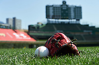 General view of a glove and baseball in the outfield grass before the Under Armour All-American Game on August 15, 2015 at Wrigley Field in Chicago, Illinois. (Mike Janes/Four Seam Images)