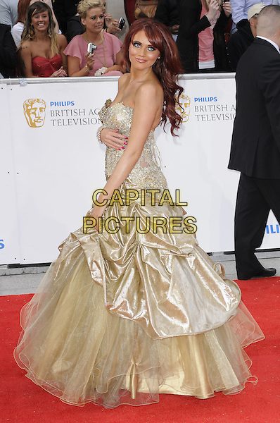 AMY CHILDS.The Philips British Academy Television Awards, Grosvenor house Hotel, Park Lane, London, England, UK, May 22nd 2011..arrivals TV Baftas Bafta full length strapless gold dress tulle side gathered silk satin maxi gown TOWIE .CAP/CAN.©Can Nguyen/Capital Pictures.
