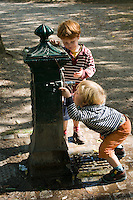 Oscar and Harry drinking from a water fountain. Bois de Boulogne.??Paul's weekend visit to Paris to look after the boys while Jack and Miranda came to London to clear John's house.??Date Taken: 18/09/10??Location:??Contact:????Commissioned by: Paul