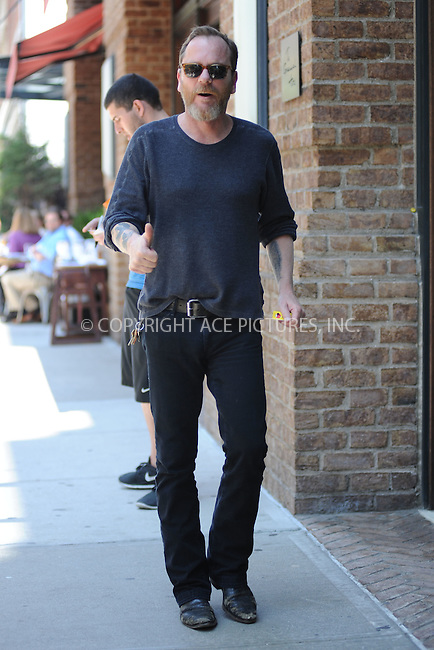 WWW.ACEPIXS.COM<br /> June 10, 2015 New York City<br /> <br /> Kiefer Sutherland was seen walking in TriBeCa on June 10, 2015 in New York City.<br /> <br /> Please byline: Kristin Callahan/AcePictures<br /> <br /> <br /> Tel: (646) 769 0430<br /> e-mail: info@acepixs.com<br /> web: http://www.acepixs.com