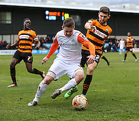 Jack Marriott of Luton Town and James Pearson of Barnet battle for the ball during the Sky Bet League 2 match between Barnet and Luton Town at The Hive, London, England on 28 March 2016. Photo by David Horn.