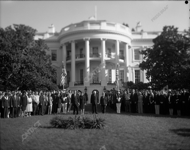 President George W. Bush and wife Laura, with Vice President Dick Cheney and wife Lynne, join the White House Staff for a moment of silence at 8:46am on the anniversary of the attack on the Twin Towers in a White House ceremony. Also attending were Chief of Staff Andy Card, and National Security chief Condoleeza Rice. September 11, 2003.