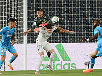18th June 2020, Alfredo Di Stefano Stadium, Madrid, Spain; La Liga football, Real Madrid versus Valencia;  Real Madrids goalkeeper Thibaut Courtois  collides with teammate Federico Valverde as he reaches for a cross