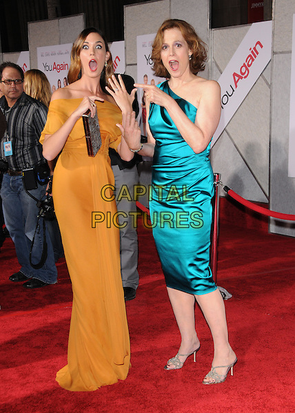 "ODETTE YUSTMAN & SIGOURNEY WEAVER ( wearing David Meister ).at The Touchstone Pictures' World Premiere of ""You Again"" held at The El Capitan Theatre in Hollywood, California , USA, September 22nd 2010 .full length one shoulder blue teal silk satin turquoise dress sandals orange long maxi clutch bag off the shoulders hand finger pointing funny .CAP/RKE/DVS.©DVS/RockinExposures/Capital Pictures."