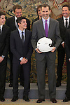 King Felipe VI of Spain receives a helmet from moto rider Marc Marquez during Royal Audience at Zarzuela Palace in Madrid, Spain. November 20, 2014. (ALTERPHOTOS/Victor Blanco)